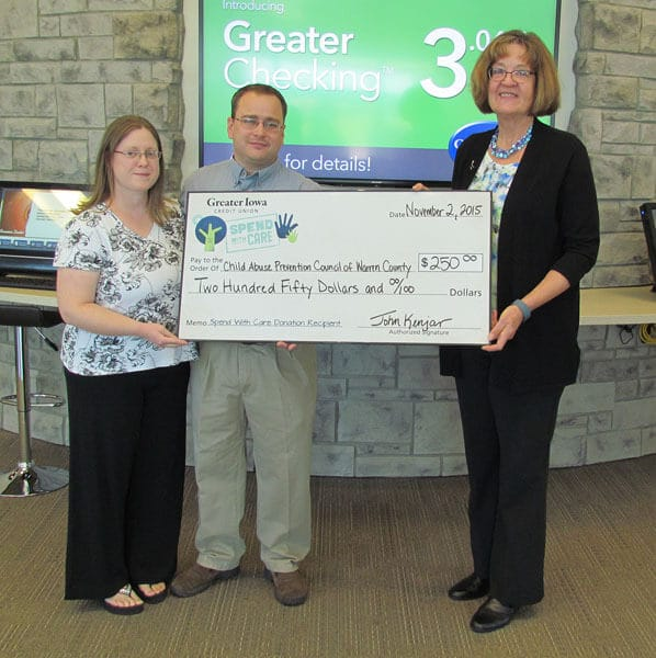 Greater Iowa Members Maxine and Scott Irish present Colleen Reisener $250 donation.