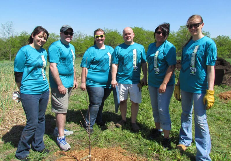 Greater Iowa staff volunteers for the Trees Forever project